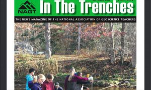 Cover of 'In the Trenches' journal.  It features State College High school students with TeenShale Network measuring stream discharge and additional water quality parameters of Black Moshannon Creek. [Photo by Earth & Environmental Systems Institute, Penn State University]